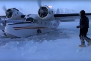 Grumman Goose seaplane in frozen water Alaska