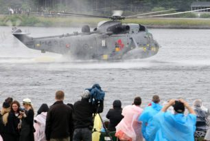 Prince William lands helicopter on water